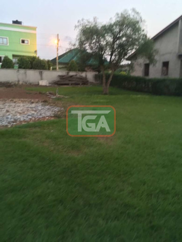 One acre of land for sale at east legon at A and c mall - 1
